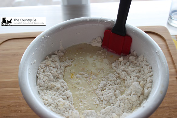 milk and egg added to flour biscuits