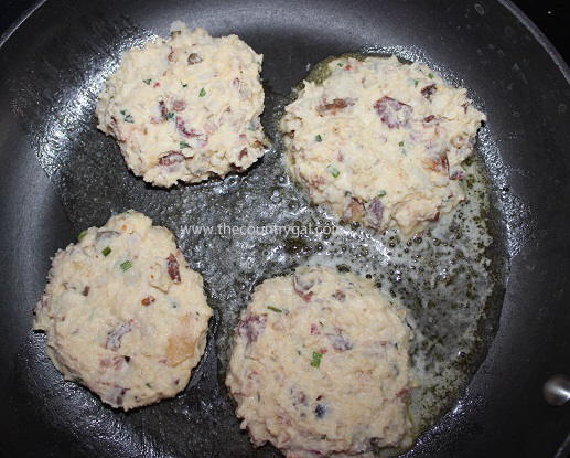 uncooked loaded potato cakes in skillet2